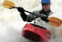 Man paddles a Dagger Crazy 88 kayak through crashing whitewater