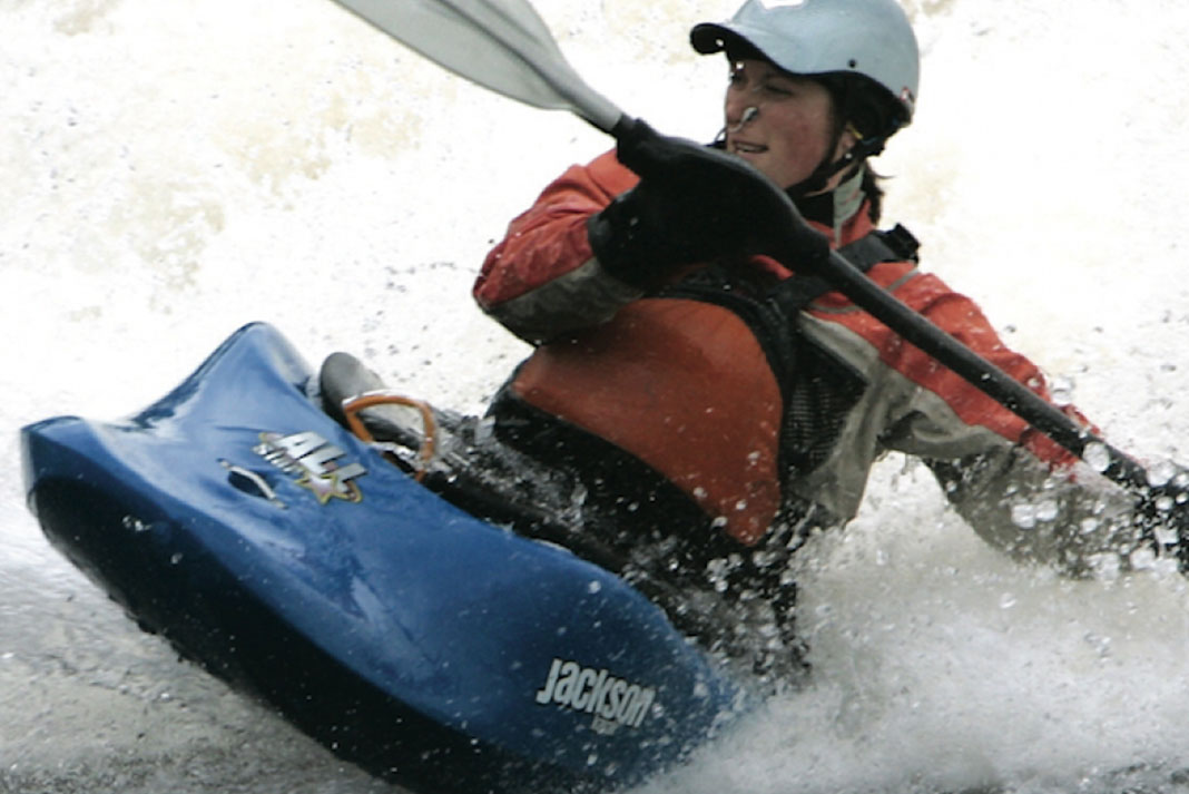 Man paddles in whitewater in the Jackson Kayak All-Star freestyle boat
