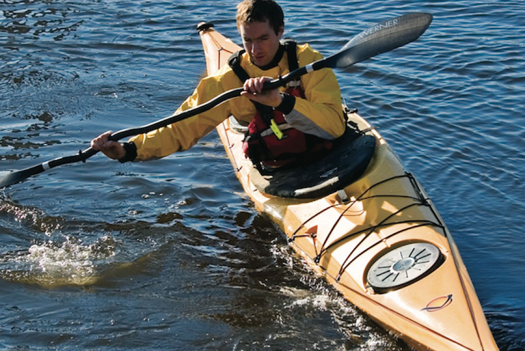 Man paddling in the Easky 15 sea kayak from Venture Kayaks
