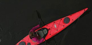 Overhead view of a man paddling the Elie Strait 140 XE light touring kayak