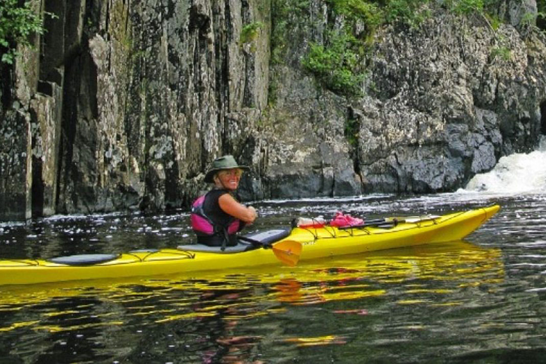 Woman paddling the Wilderness Systems Tempest 165 expedition kayak