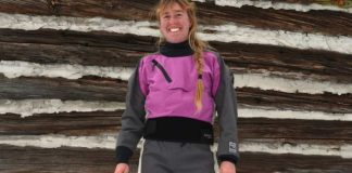 Woman wearing a purple and black drysuit