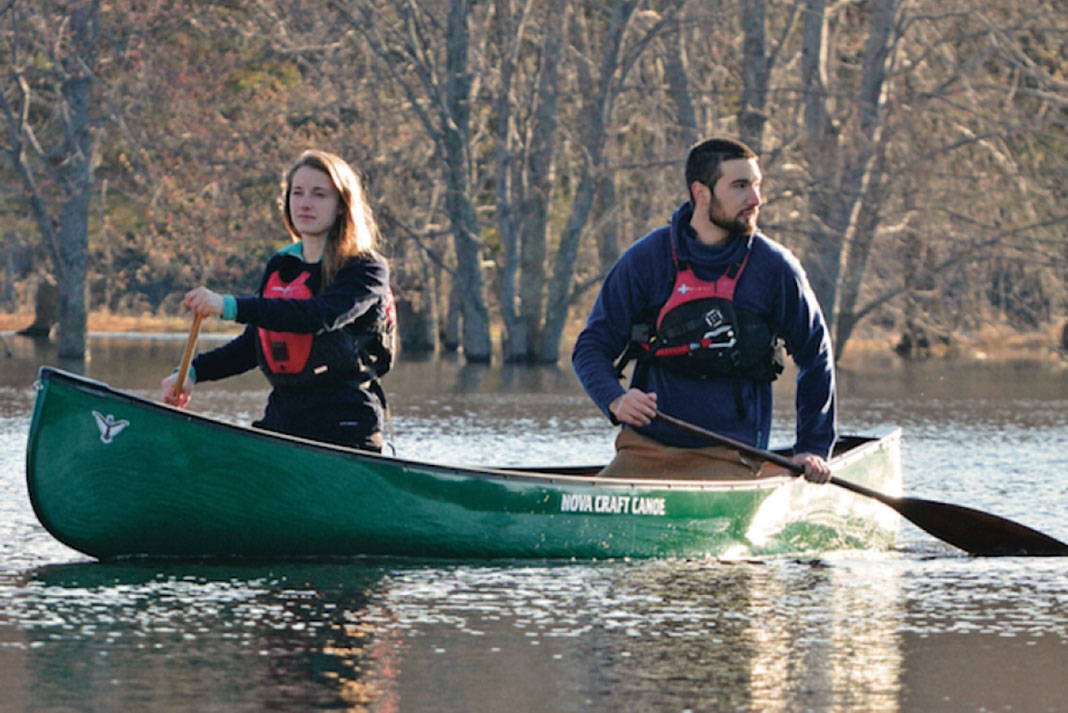 Man and woman paddle in a Nova Craft Bob Special canoe