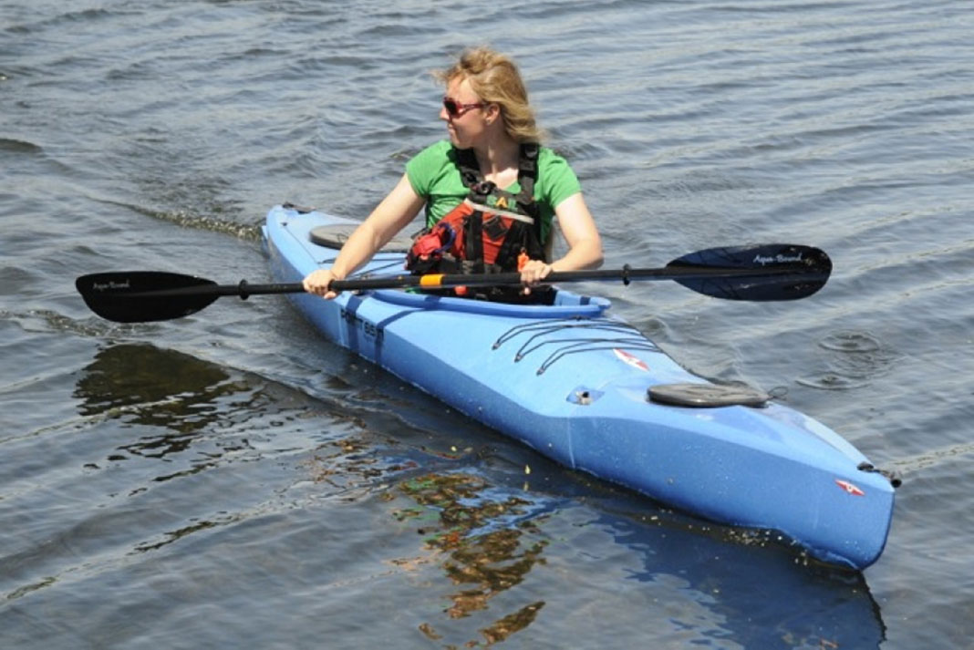 Woman paddling the Mercury GTX kayak from Point 65