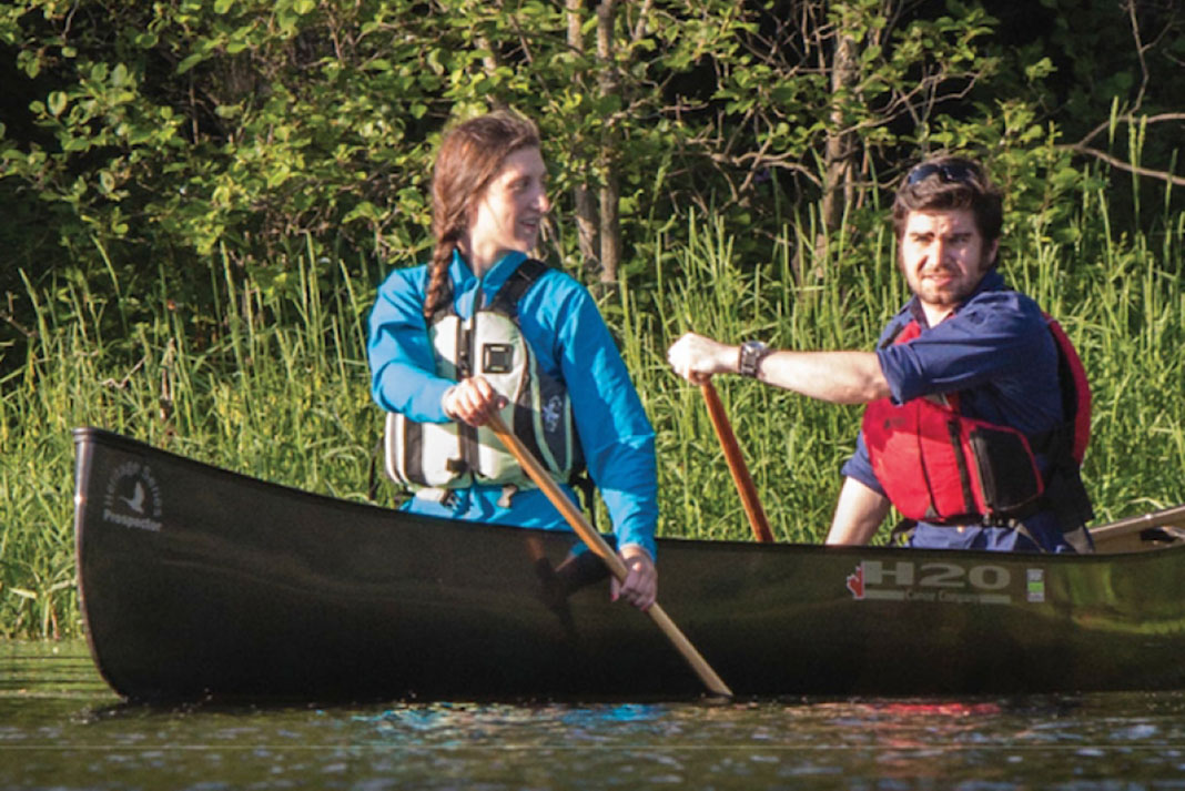 Man and woman paddle the H2O Prospector 15-4 tandem tripping canoe