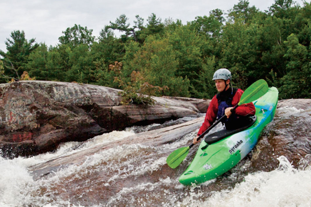 Man paddling the Pyranha Burn 3 kayak in river rapids