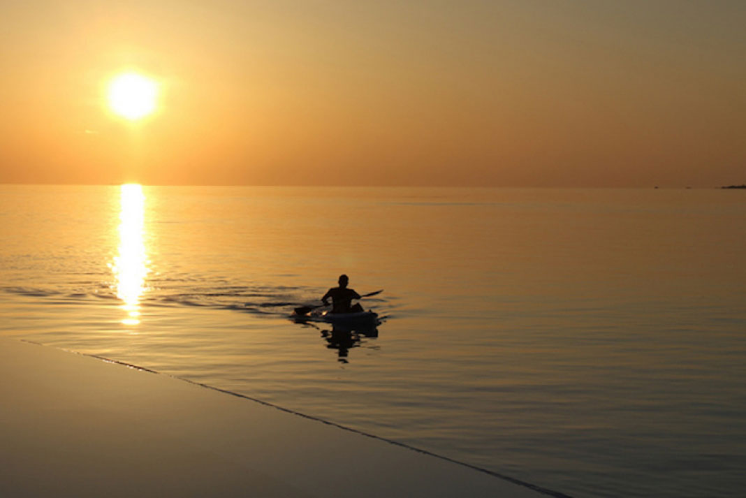 a kayaker at sunset, hopefully after receiving some kayak gifts for dad