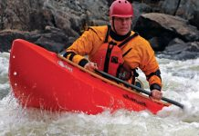 Man paddles through whitewater in a Silverbirch Covert 9.3 canoe