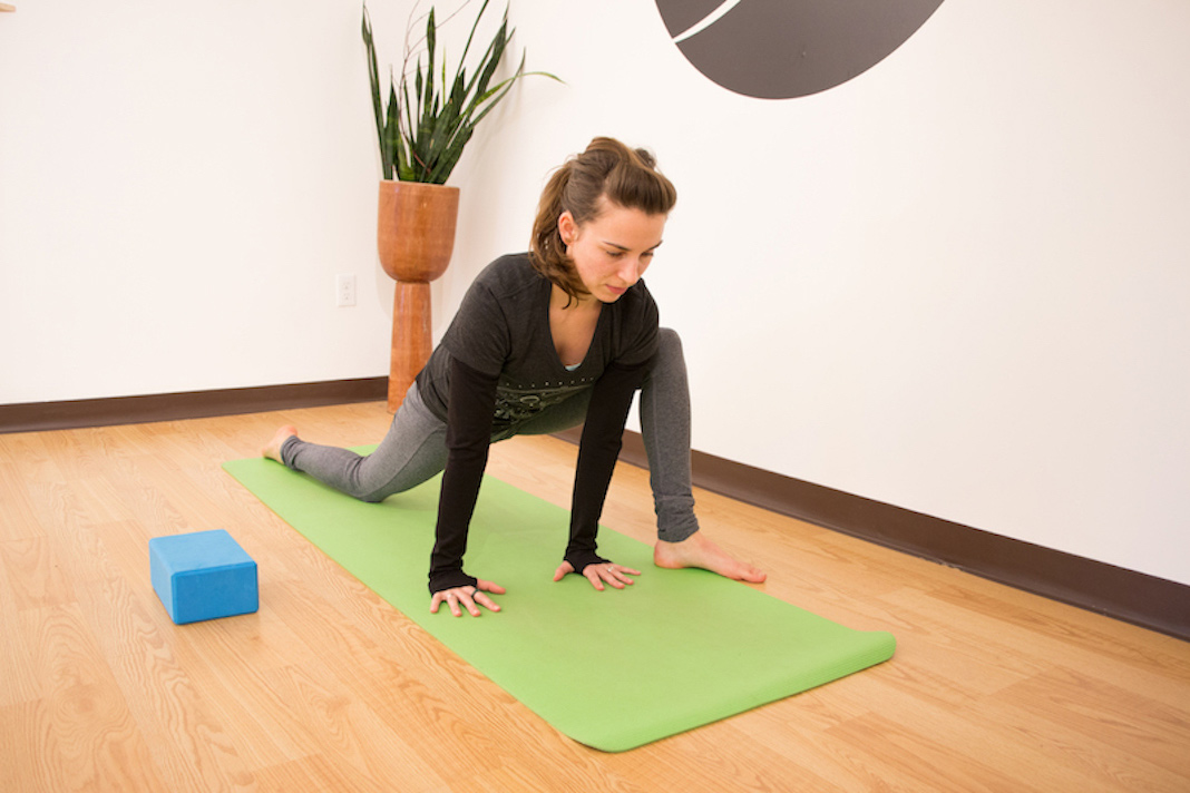 Woman lunging on yoga mat