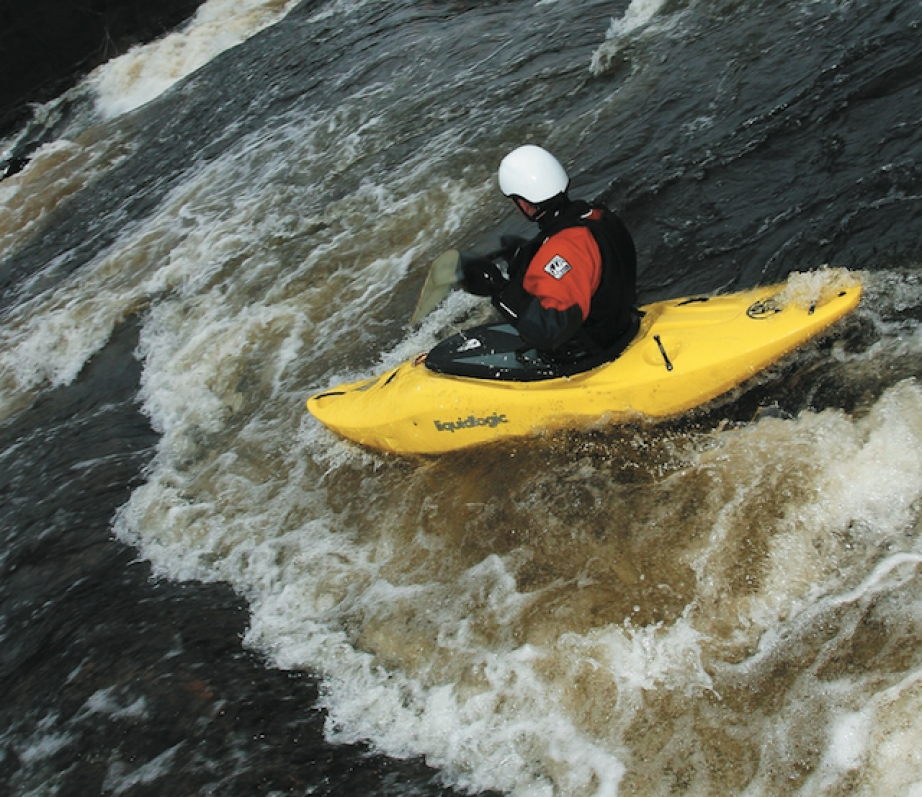 Kayaker paddling Liquidlogics' Lil' Joe kayak down whitewater