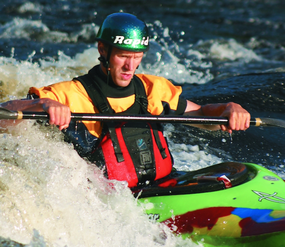 Scott MacGregor surfing on a wave on the Ottawa River in Dagger Kayak's GT