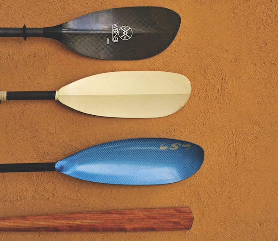 four different kinds of kayak paddle blades in a row