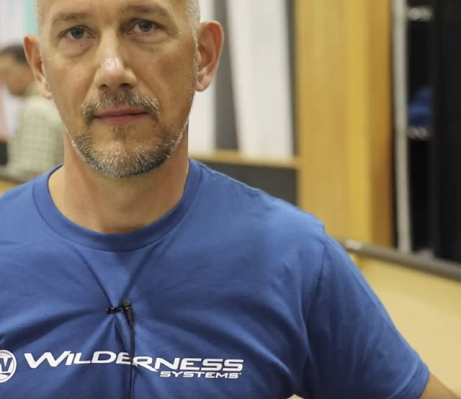 Shane Steffan from Mad River Canoe wearing a Wilderness at Paddling Retail