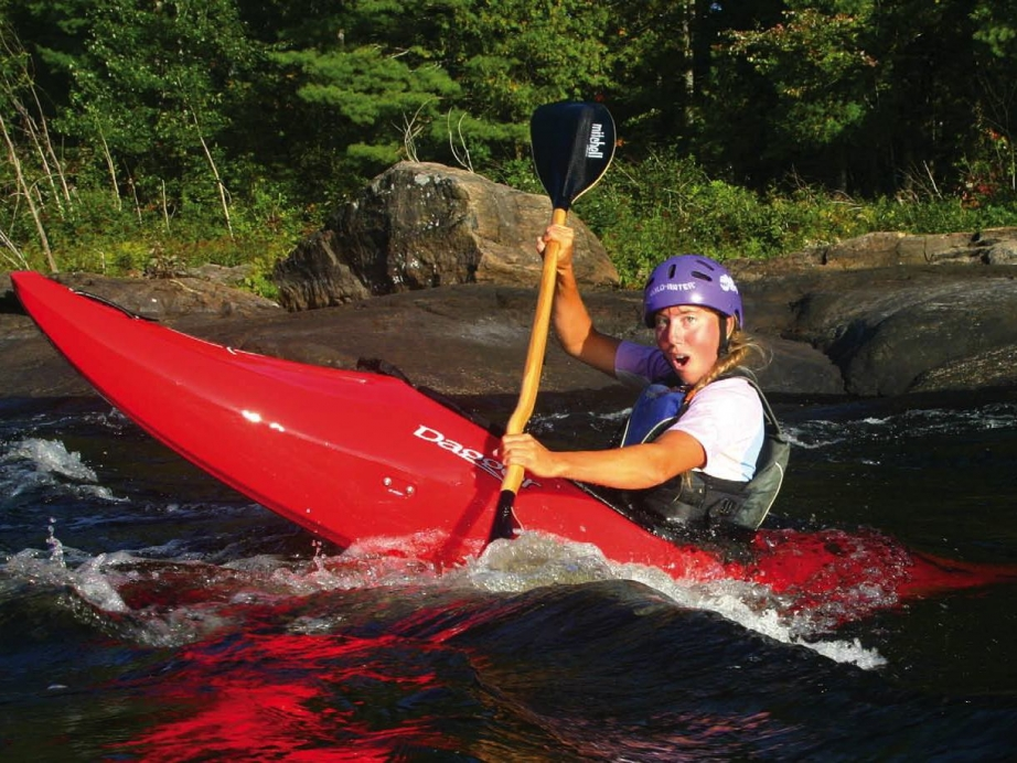 Virginia Marshall playing in whitewater rapids in the Dagger Axiom kayakPhoto: Stephanie Park