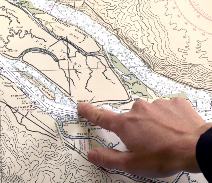 A kayaker plans his trip on a map before going out on the water.