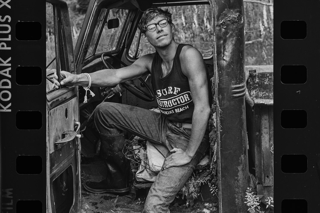 man sitting in an old truck