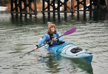 Woman paddling in an Old Town Castine touring kayak
