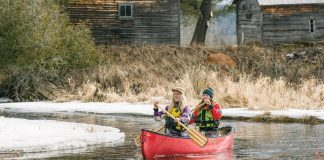 two women paddling a protecter 15 canoe