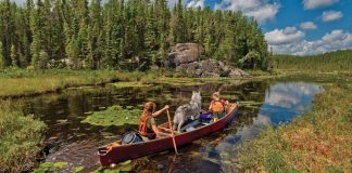 Two people on a canoe trip through a lake in the Souris River Quetico 18.5