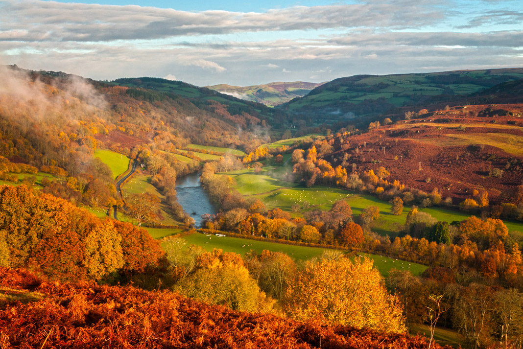 Scenic view of rolling mountains and fields surrounding the River Wye