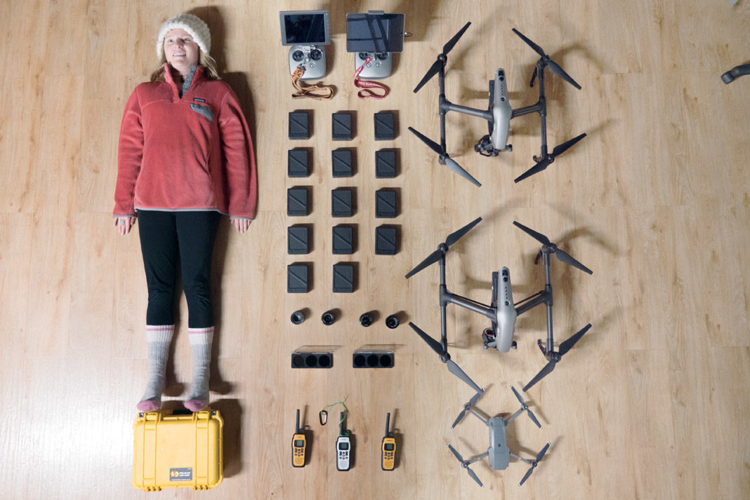 woman surrounded by drone equipment