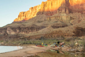 campsite in Grand Canyon with a sunset and kayaks