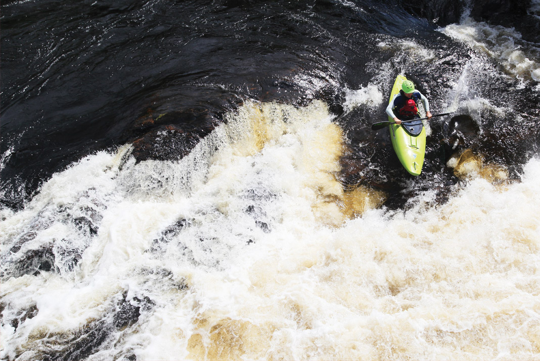 Person running a rapid in the Liquidlogic Mullet whitewater kayak