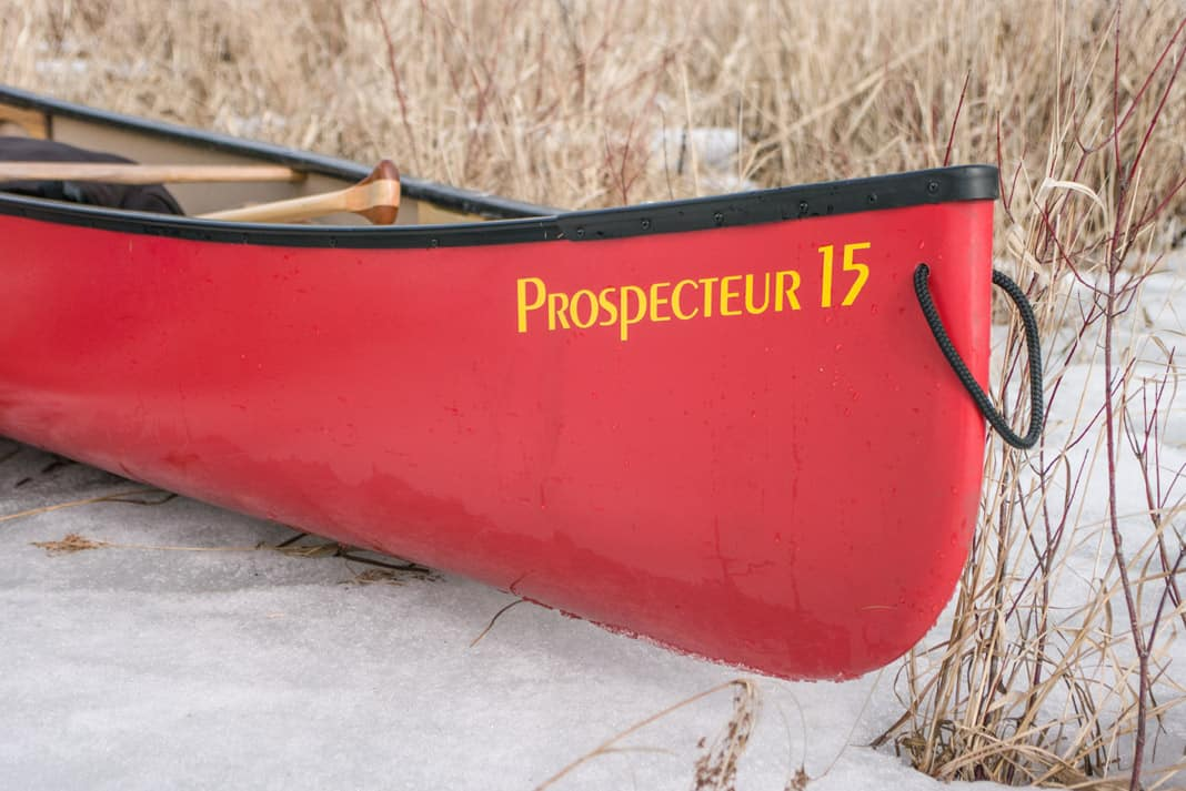 red canoe that says Prospecteur 15 on the bow