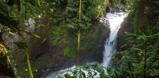 Dropping a waterfall while whitewater kayaking in Mexico