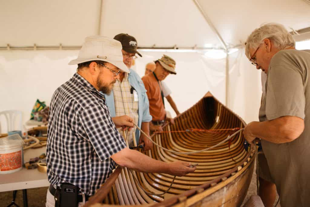 Using rope to measure hull shape on wooden canoe