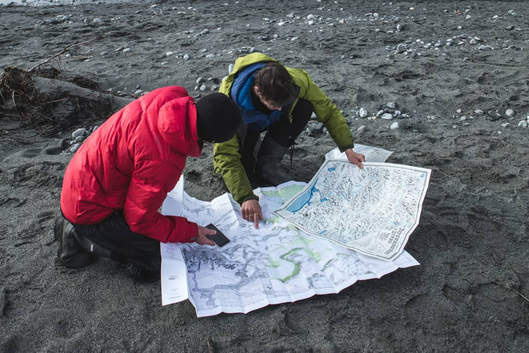 two men looking at maps of the Tatshenshini and Alsek rivers
