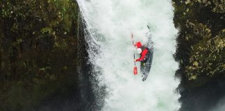 a kayaker hucking off a waterfall, one of many kayaking slang terms