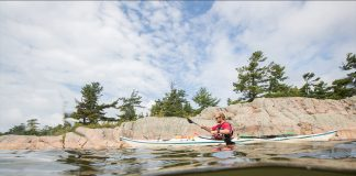 Kayak Accessories and Gear | Man paddling a kayak on the Great Lakes