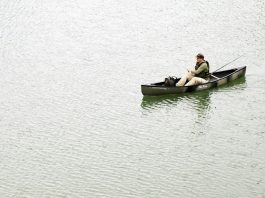 Man fishing from canoe