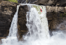 kayak going over waterfall