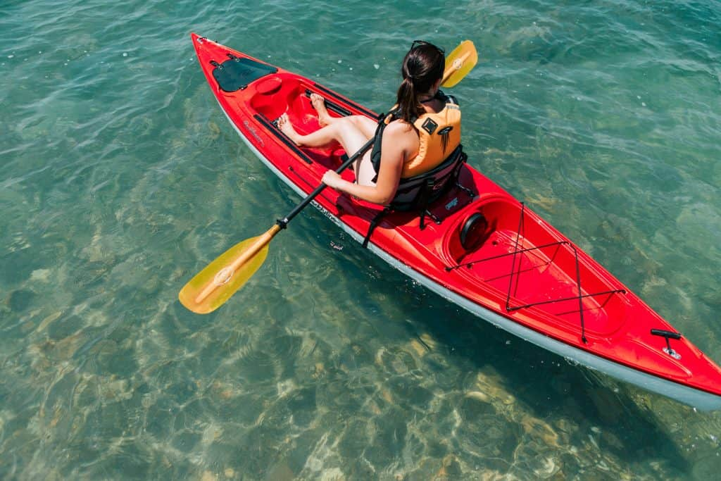 Woman paddling in a sit-on kayak