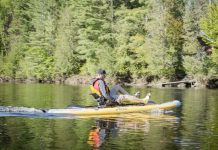 Man paddles a Hobie Mirage i11S inflatable kayak/paddleboard hybrid