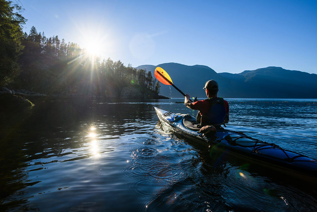 Photo of kayaker with paddle