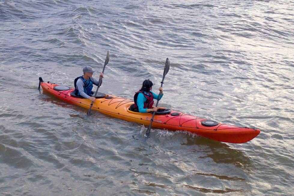 Two people in a tandem sit-in kayak