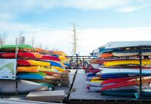 Canoes and kayaks in storage on canoe stands
