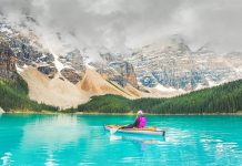 Woman in kayak on Moraine Lake in Banff National Park.