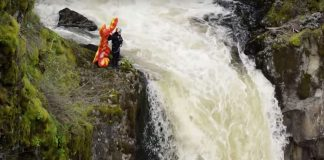 Rafa Ortiz standing above Outlet Falls with inflatable lobster