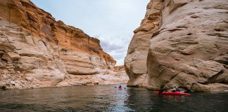 Kayaks with canyon walls on either side