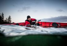 kayaker tests out the stability of a kayak
