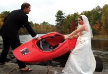husband and wife fight over a kayak at wedding