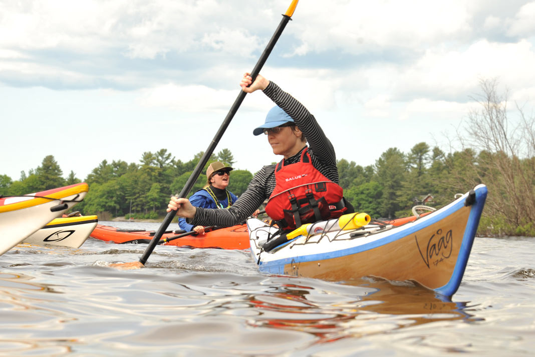 Two women practicing sea kayaking skills.