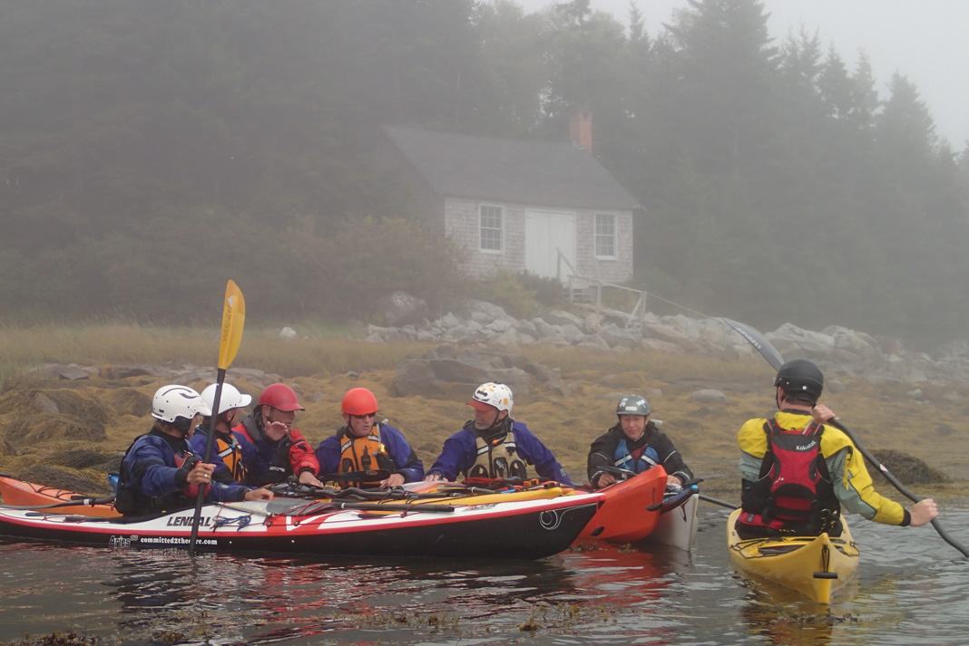 Sea kayakers gathered in a group on the water