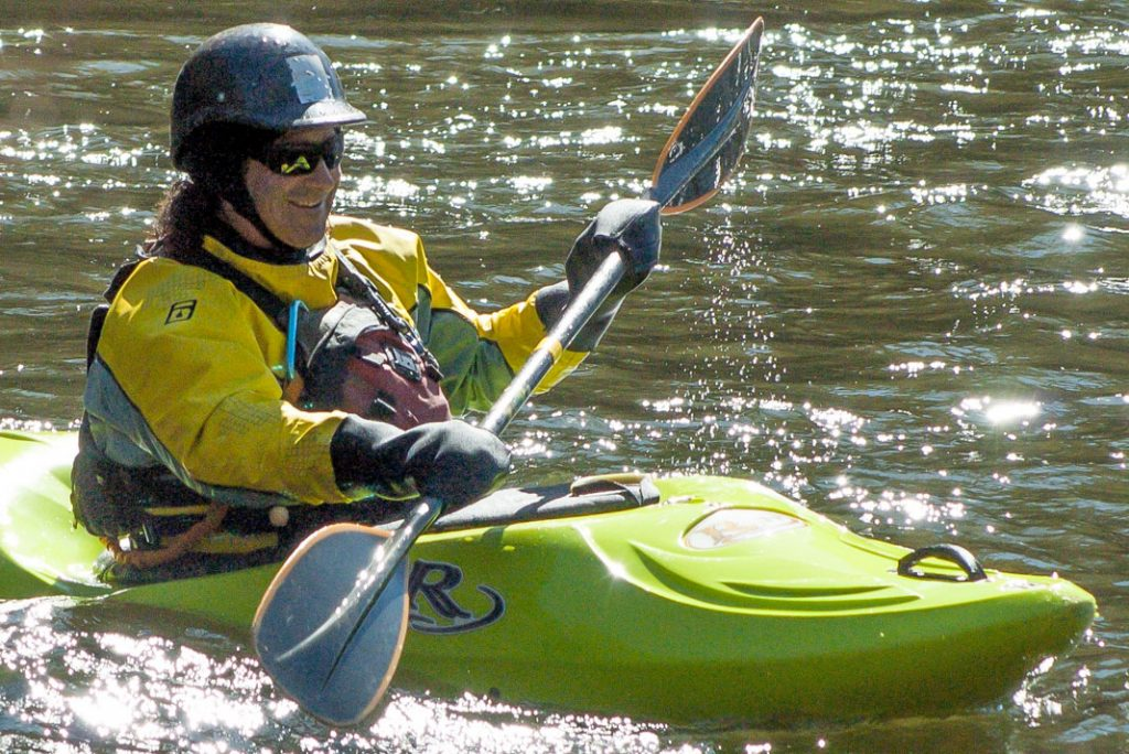 Person using kayak pogies