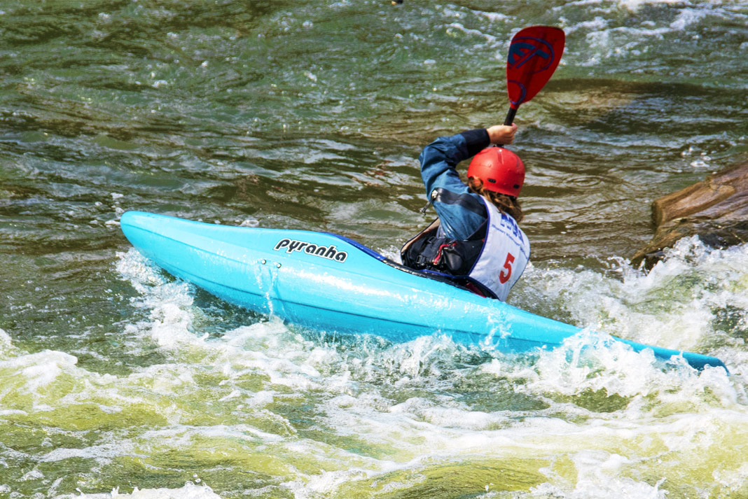 Person in blue whitewater kayak