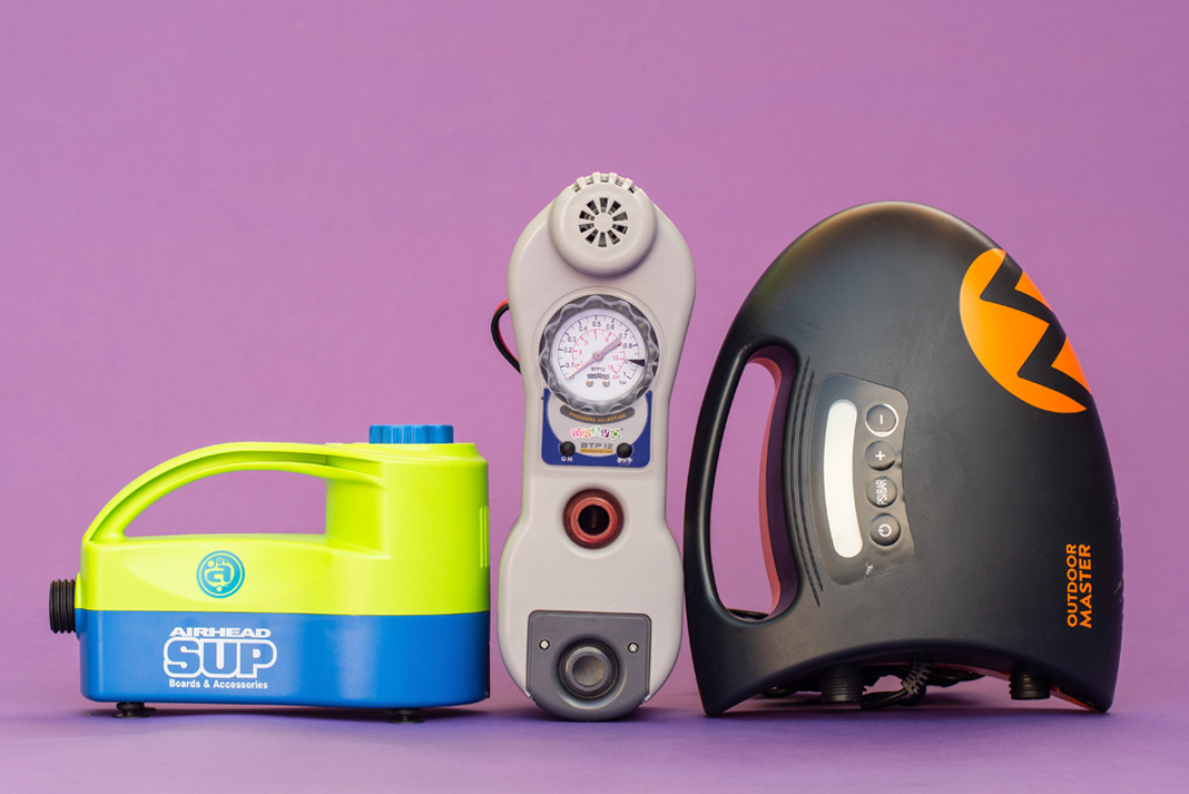 Three electric SUP pumps on a purple background